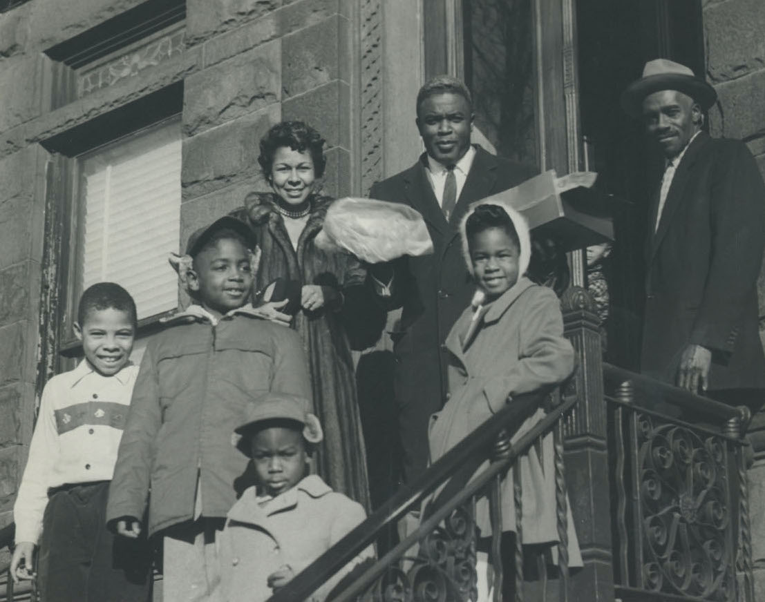 Robinson family and others on steps of Covington family home, Brooklyn, ca. 1956