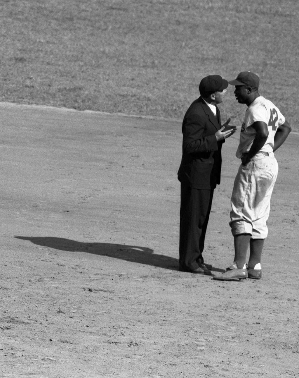 Jackie Robinson argues with an umpire after disagreeing with a call, 1952<br/>Courtesy of the Bettmann Archive, Getty Images