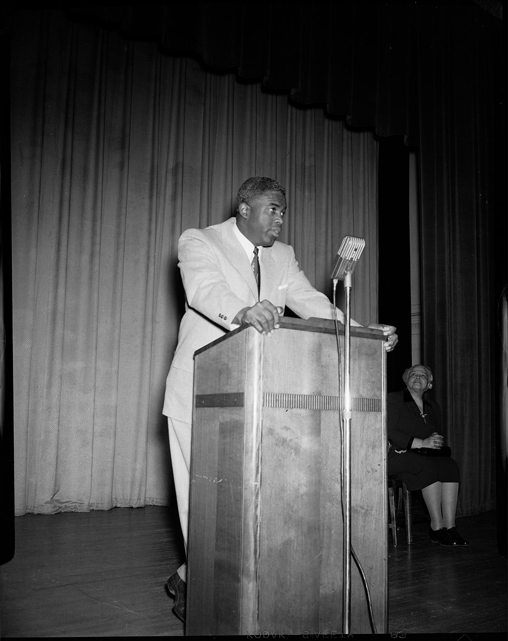 Jackie Robinson speaks at podium at the NAACP 50th anniversary event, 1959<br/>Jackie Robinson Museum Collection